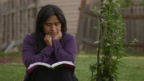 Hispanic Woman Meditates During Worship Time. In Back Yard at home stock video