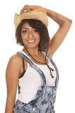 Hispanic woman overalls hand hat smile Royalty Free Stock Image