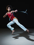 Hispanic woman playing capoeira martial art Stock Image
