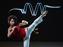 Hispanic woman playing capoeira martial art Royalty Free Stock Images