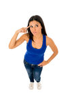 Hispanic woman pointing her head thinking and wondering confused Royalty Free Stock Images