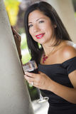 Hispanic Woman Portrait Outside Enjoying Wine Stock Images