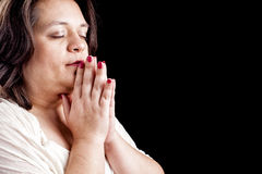 Hispanic woman Praying Stock Image