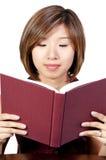 Hispanic Woman Reading a Book Stock Image