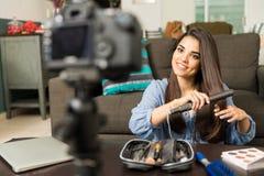 Hispanic woman recording video blog Royalty Free Stock Images