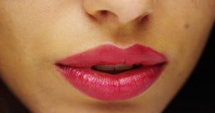 Hispanic woman's red luscious lips. Closeup of Hispanic woman's red luscious lips royalty free stock photos