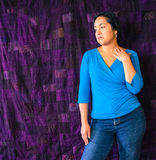 Hispanic woman sad, unhappy. Young Hispanic woman standing with eyes looking down, sad, unhappy, mouth in frown Stock Images