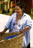 Hispanic woman  sells outside Stock Photo