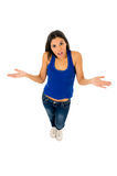 Hispanic woman shrinking shoulders open arms wondering confused in doubt Royalty Free Stock Photo