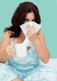 Hispanic woman sick with the flu Royalty Free Stock Image