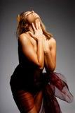 Hispanic woman in silk. Beautiful hispanic woman wrapped in silk royalty free stock photo