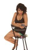 Hispanic woman sit chair look at music Stock Photo