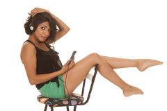 Hispanic woman sit chair music look Stock Photo