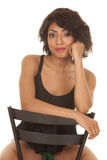Hispanic woman sit chair red lips smile Royalty Free Stock Photography