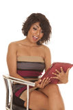 Hispanic woman sit with tablet shock Royalty Free Stock Images