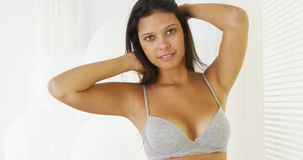 Hispanic woman standing by window in underwear Royalty Free Stock Photos