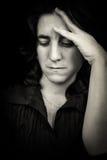 Hispanic woman suffering a headache Stock Image