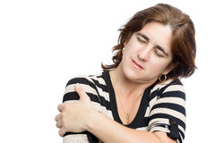 Hispanic woman suffering from shoulder pain Royalty Free Stock Photo