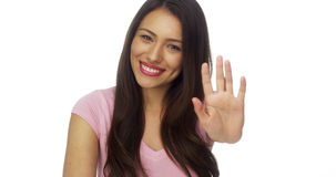 Hispanic woman talking to camera and reaches hand out Royalty Free Stock Photos