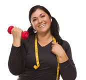 Hispanic Woman with Tape Measure Lifting Dumbbell Stock Photo