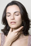 Hispanic woman with throat pain Royalty Free Stock Images