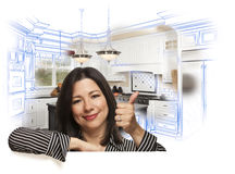 Hispanic Woman with Thumbs Up, Kitchen Drawing and Photo Behind stock image