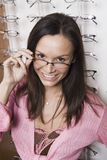 Hispanic Woman Trying On Eye Glasses Stock Photography
