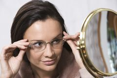 Hispanic Woman Trying On Glasses Royalty Free Stock Photography