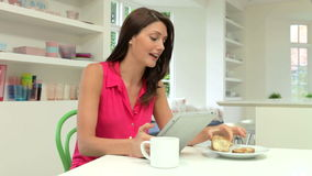 Hispanic Woman Using Digital Tablet In Kitchen At Home stock footage
