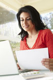 Hispanic Woman Using Laptop In Home Office Royalty Free Stock Photos