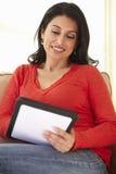 Hispanic Woman Using tablet computer At Home Royalty Free Stock Photo