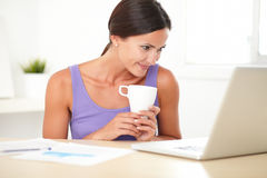 Hispanic woman using the web for business Royalty Free Stock Photo