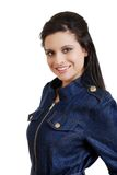 Hispanic woman wearing jean top smiling Royalty Free Stock Image