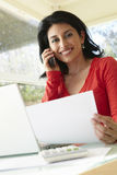 Hispanic Woman Working In Home Office Royalty Free Stock Photography