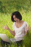 Hispanic woman working laptop computer Royalty Free Stock Images