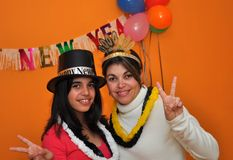 Hispanic women celebrating New Years Eve Royalty Free Stock Image