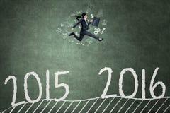 Hispanic worker running to achieve numbers 2016 Stock Photos