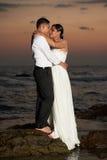 Hispanic young couple kissing on beach Stock Image