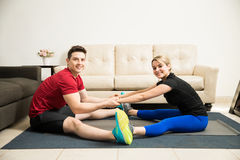 Hispanic young couple stretching together Stock Photo