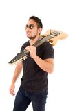 Hispanic young man holding electric guitar Stock Photo