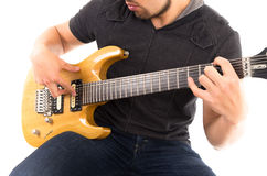 Hispanic young man playing electric guitar Stock Photos