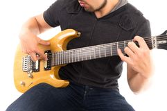 Hispanic young man playing electric guitar Stock Photo