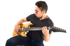 Hispanic young man playing electric guitar Stock Image