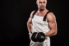 Hispanic young muscular man doing heavy dumbbell exercise for bi Royalty Free Stock Photo