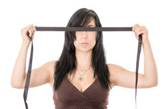 Hispanic young woman blindfolded. Black cloth Stock Image