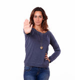 Hispanic young woman gesturing stop sign Royalty Free Stock Photography