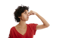 Hispanic young woman holding breath. Hispanic woman holding breath closing nose with fingers on white background Royalty Free Stock Images