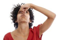Hispanic young woman holding breath. Hispanic woman holding breath closing nose with fingers on white background Royalty Free Stock Photo