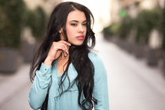 Hispanic young woman wearing casual clothes in urban background Stock Image