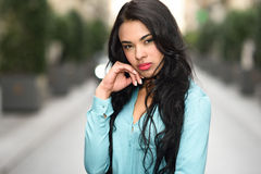 Hispanic young woman wearing casual clothes in urban background Royalty Free Stock Image